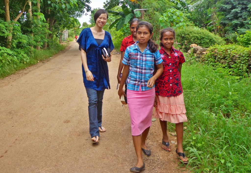 Confident orphan kids walking back from church with Sharon Yeap, a volunteer from Singapore.
