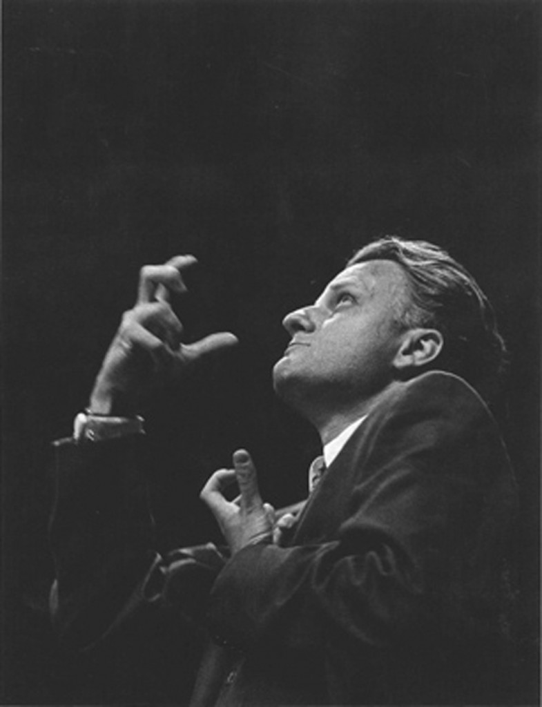 Billy Graham at the 1957 NYC Crusade. Photo: Robert Capa/Bullfinch Press