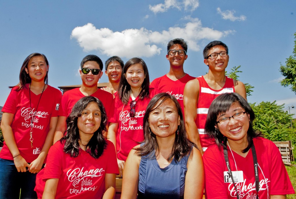 Delia Kim of New Life Fellowship & the Young Governors, a nonsectarian group, rally to save Elmhurst Community Garden. Top row l to r: Annie Wang, Stephen Sam, Tony Fang, Chaochi Lee, Tala Haider, Perry Chu. Bottom row l to r: Angie Pangol, Delia Kim, Nhi Tong