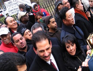 Cabrera & his wife Elvia rallied city leaders to support religious groups right to worship in public schools in the off hours. John Liu in background on the right. Photo: Christopher Smith/A Journey through NYC religions