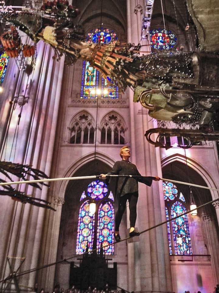 "Philippe Petit walked on a tight rope across St. John the Divine for the opening ceremony of Xu Bing's ""Phoenix"" art sculptures. Petit often looked up during his stunt to admire the soaring birds. Mobile photo: Melissa Kimiadi/A Journey through NYC religions"