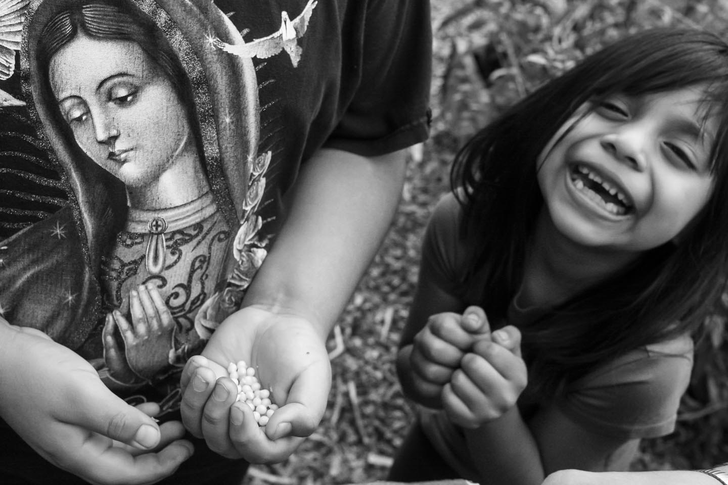 Photo of smiling young girl in a Bronx farm called La Finca del Sur, next to t-shirt showing the Virgin Mary. Photo: David Gonzales
