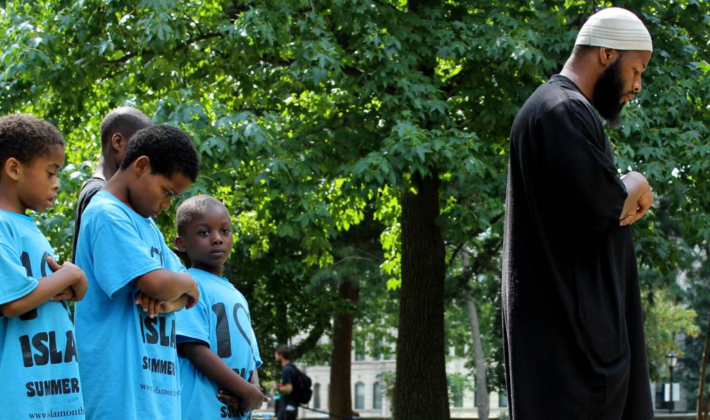 Learning to pray to Allah in Prospect Park with Teacher Mustafaa Abdul-Hakeem of I Love Islam summer camp and Islam on the Move. Photo: Pauline Dolle/A Journey through NYC religions