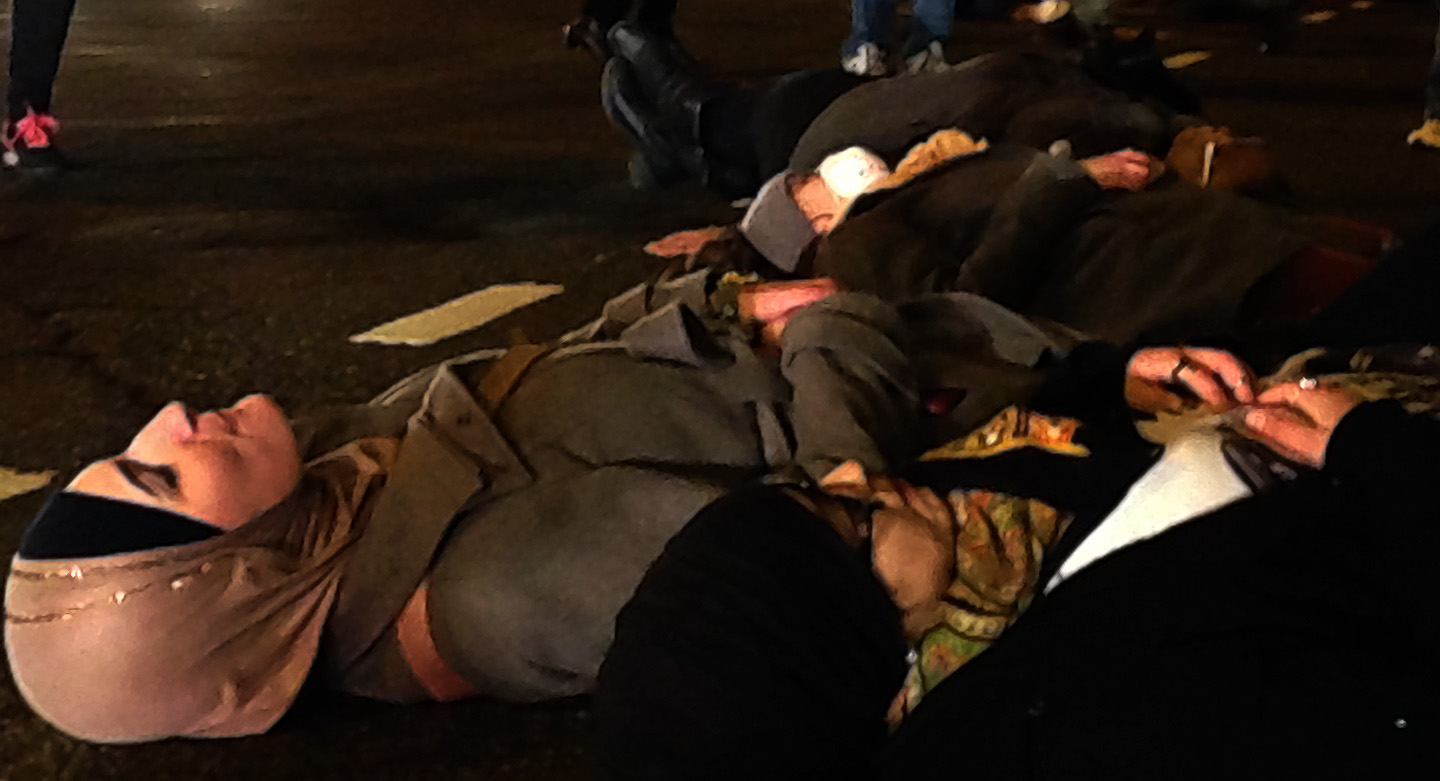 Die-in at Canal and Thompson Street by Linda Sarsour, executive director of the Arab American Association of New York, and Ravia Ahsin Tarar, student from Columbia University. Photo: Pauline Dolle/A Journey through NYC religions