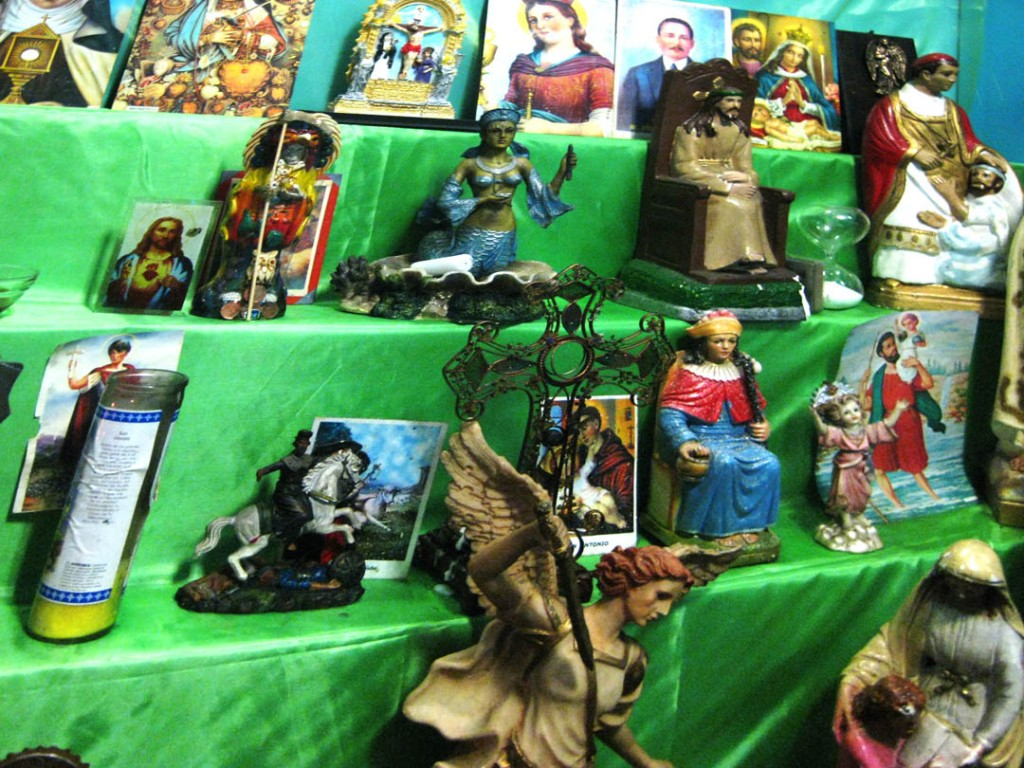 Since she was a teenager, Rojas has collected saints from Catholicism, Santeria, Palo, Chinese religion and Italian traditions. Photo: Pauline Dolle/A Journey through NYC religions