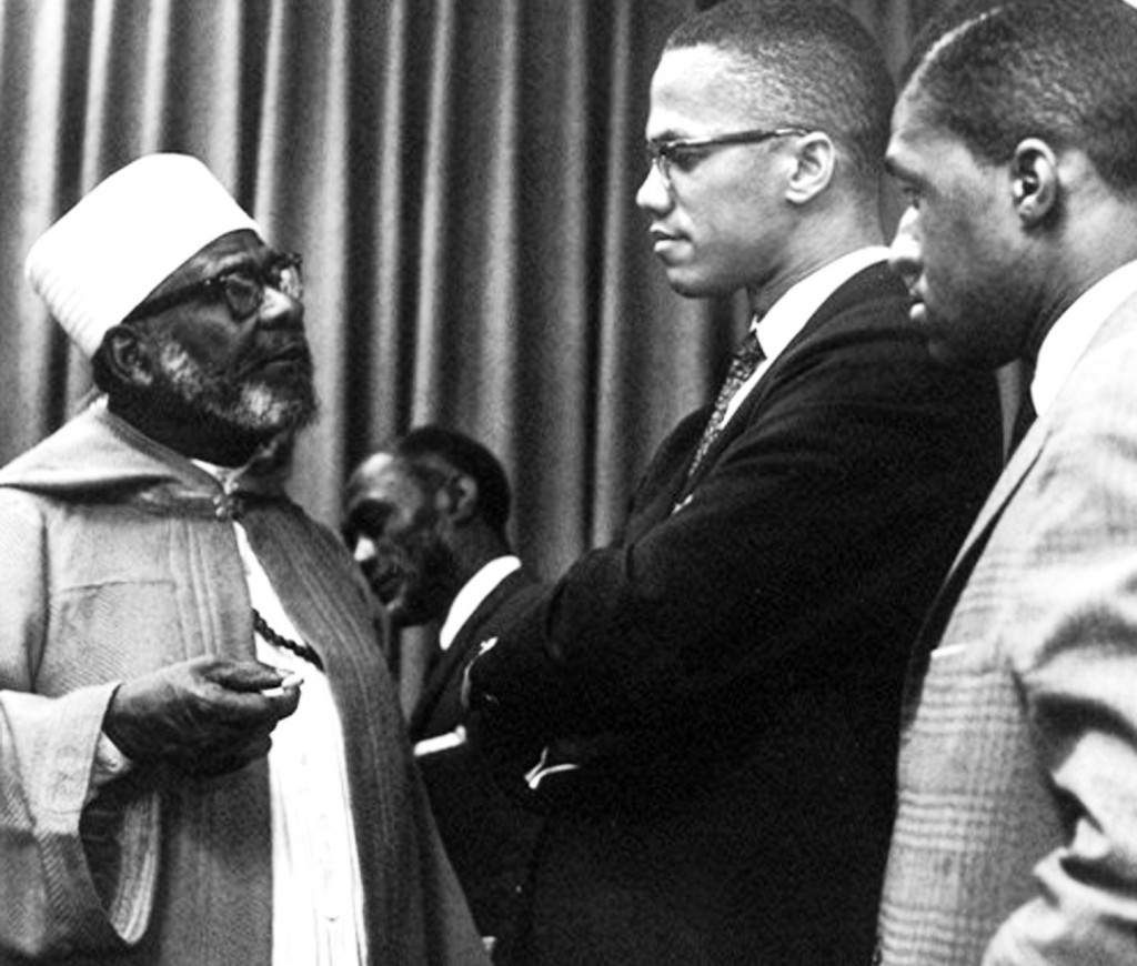 Shaikh Daoud Ahmed Faisal, l, speaking to Malcolm X, c, at United Nations in 1963. Source: mancebomosaic.com