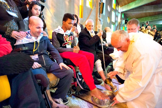 Pope Francis washing the feet of the disabled