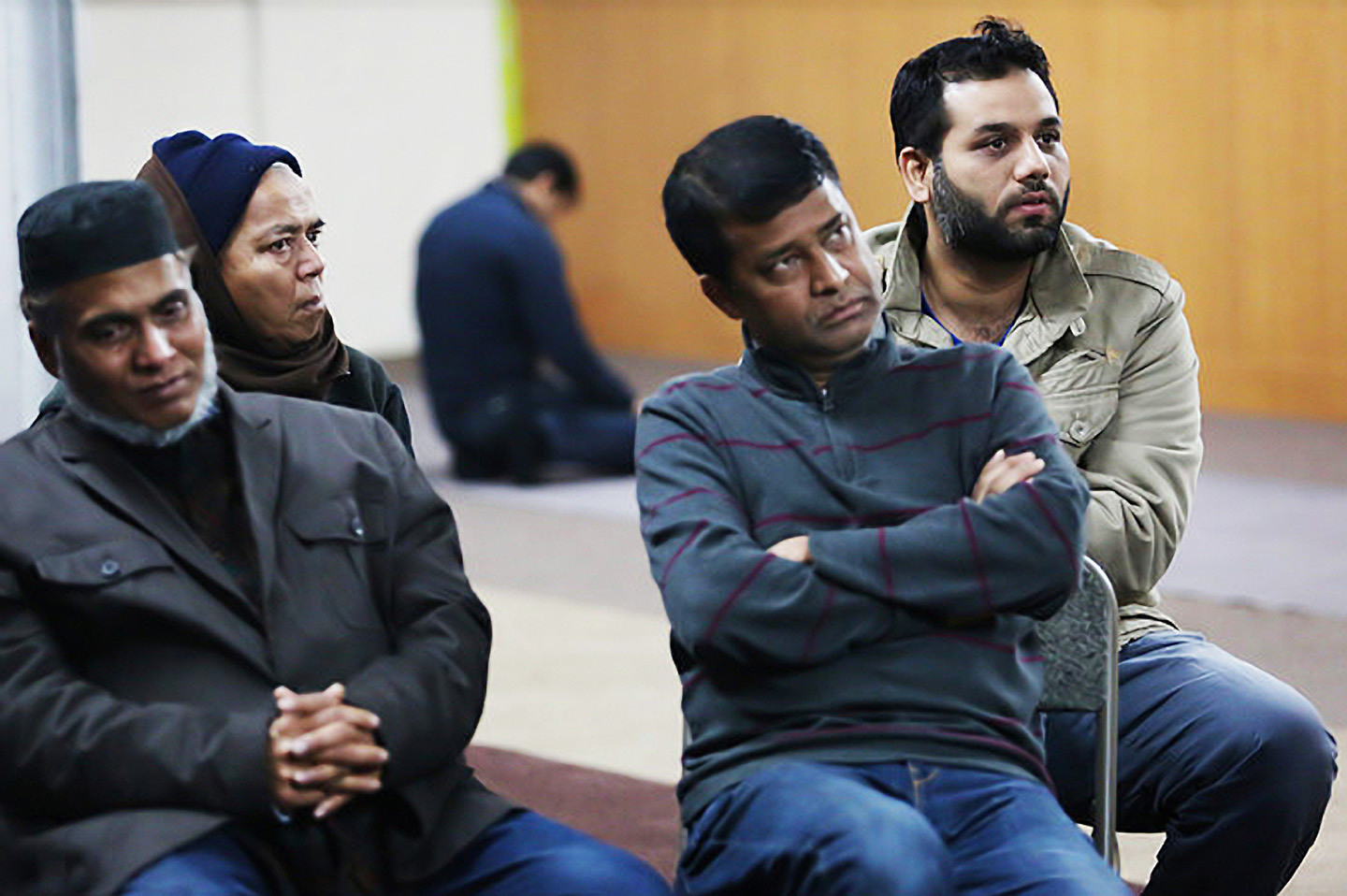People gathered at the Arafa Islamic Center on Monday to discuss Donald J. Trump's statements advocating that Muslims be barred from entering the United States. Credit Kirsten Luce for The New York Times