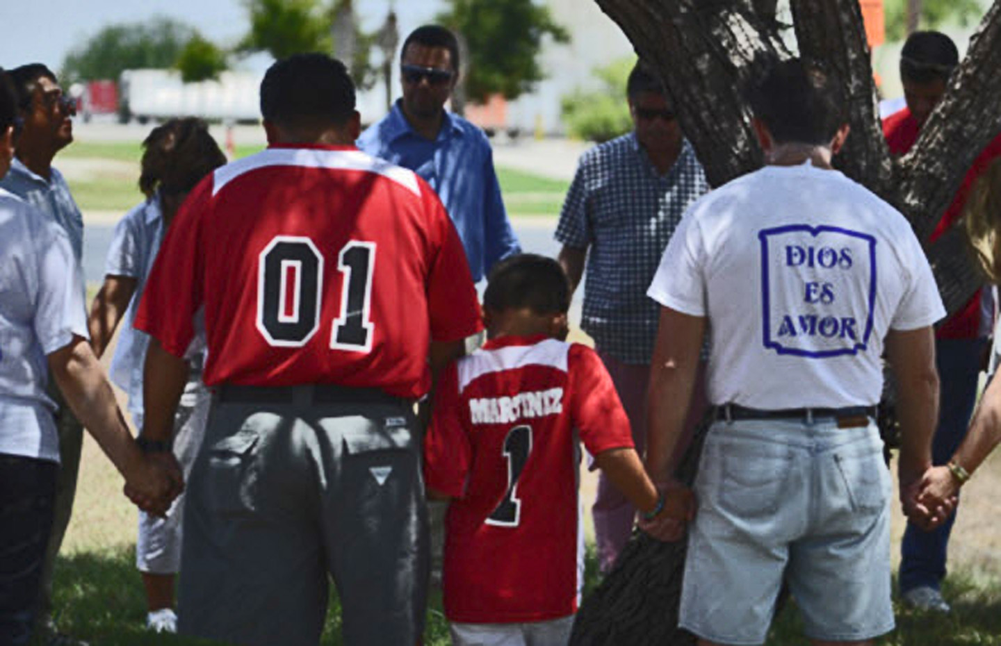 Texas Baptists pray in McAllen outside immigrant processing center. Photo: Leah Allen/Texas Baptist Communications