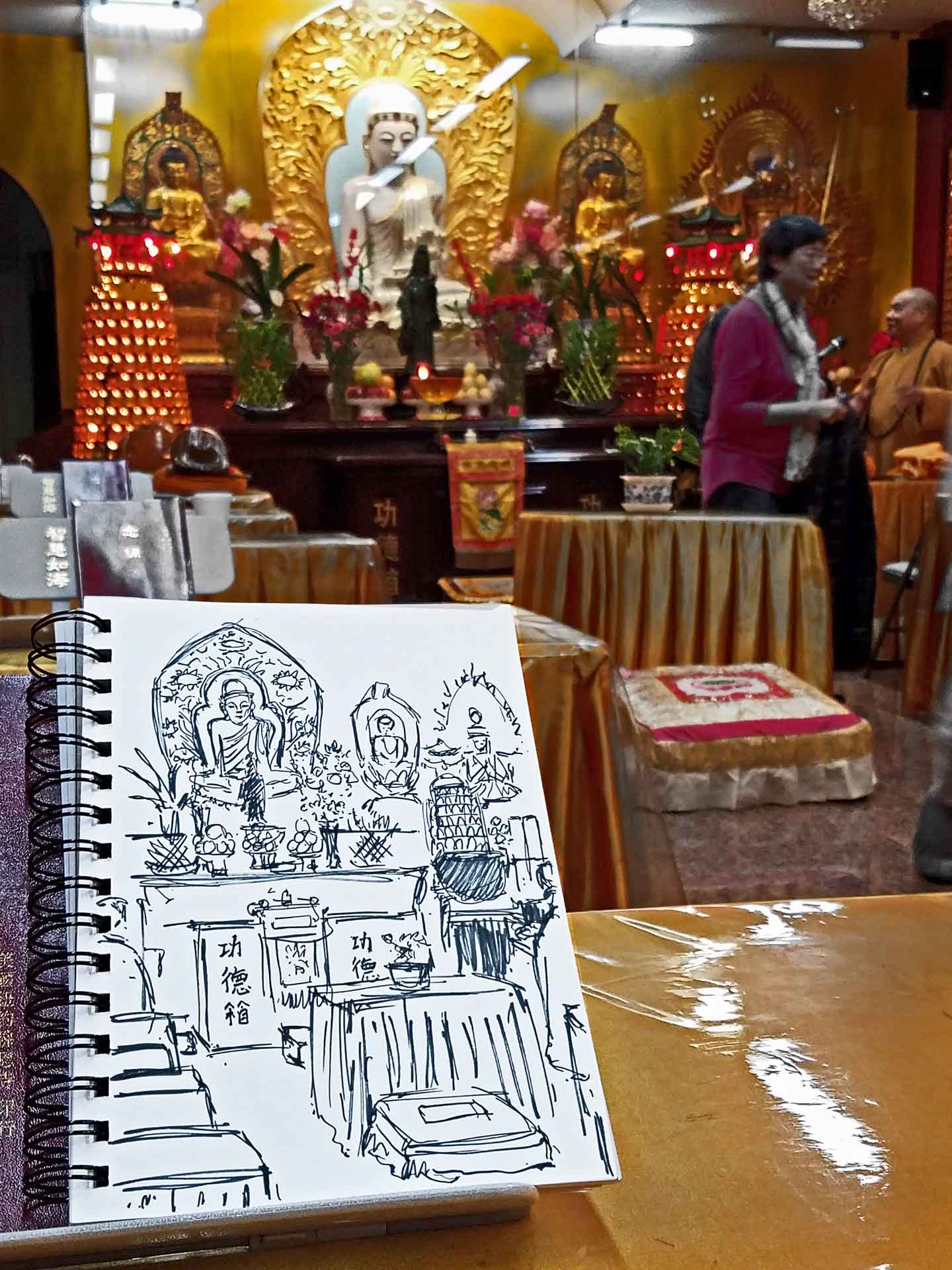 Interior of Puchao Temple, afternoon prayer service. Illustration by Darilyn Carnes/A Journey through NYC religions